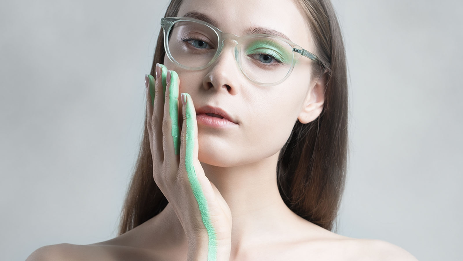 paint on model wearing clear sunglasses