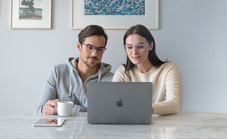 Man and woman with Eyezen glasses