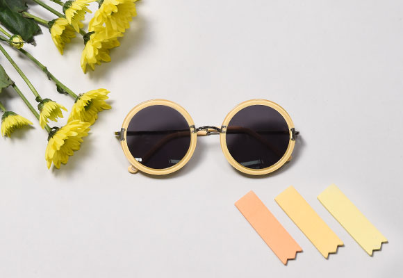 Yellow sunglasses left